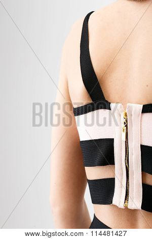 Young Woman's Back With Zipper On Dress