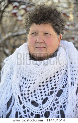 elderly woman in  white knitted shawl costs about Rowan
