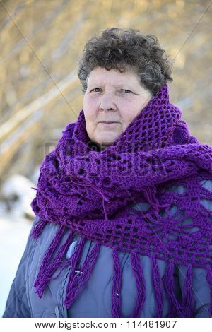 woman with purple knitted shawl on his shoulders outdoors in winter