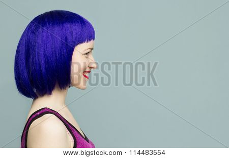 Profile of a smiling girl in a blue wig with red lips on a blue background