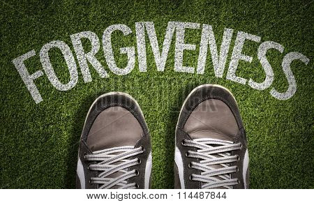 Top View of Sneakers on the grass with the text: Forgiveness