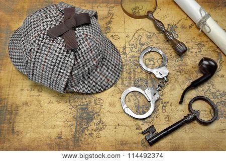 Deerstalker Hat And Detective Tools On Map