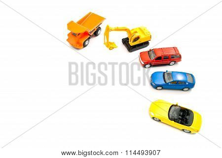 Truck, Yellow Backhoe And Cars