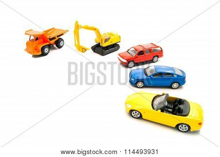 Truck, Yellow Backhoe And Other Cars