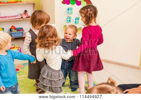 Group of little children dancing