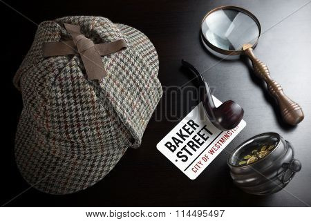Deerstalker Hat Vintage Clock Retro Magnifier And Smoking Pipe On The Black Table Background. Overhead View. Investigation Concept.