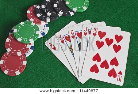 Royal Flush Of Hearts And Poker Chips