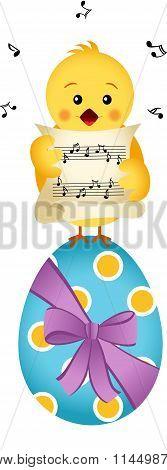 Chick singing on Easter egg