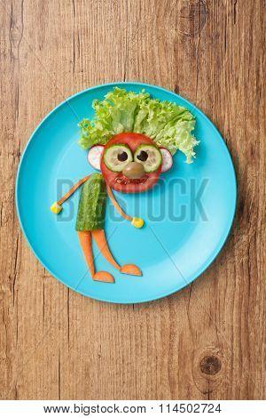 Man Made Of Vegetables On Bule Plate