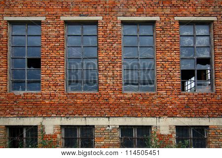 Old Brick Wall With Broken Windows