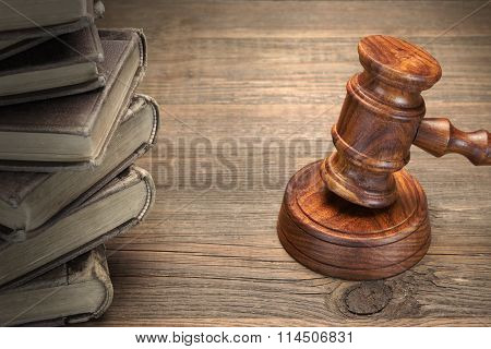 Wooden Judges Gavel And Old Law Books On Wooden Table
