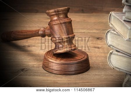 Wooden Jydjes Gavel And Old Law Books On Wooden Table