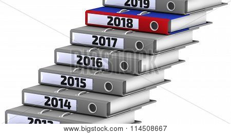 Folders stacked in the form of steps, marked the years 2014-2018. Focus for 2018