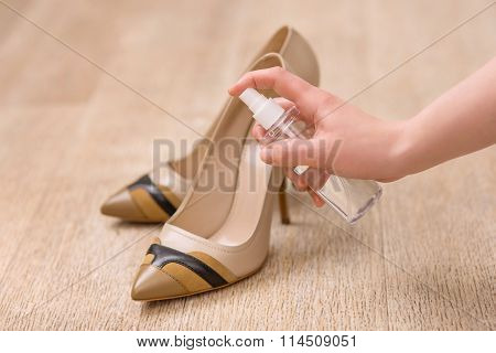 Good woman taking care of her shoes
