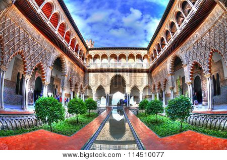 The Courtyard of the Maidens patio in Royal Alcazars of Seville Spain in HDR through fisheye lens