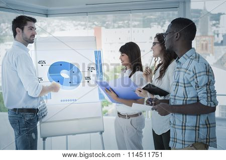 Global business interface against man presenting and coworkers taking notes
