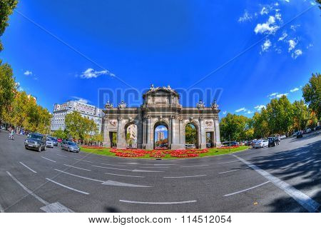Artistic colorful image of Puerta de Alcala (Alcala Gate) in Madrid Spain in HDR (high dynamic range