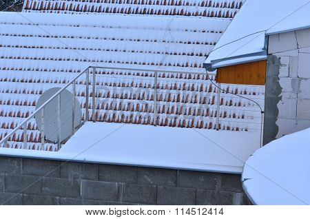 Snow-covered roof and satellite dish antenna.