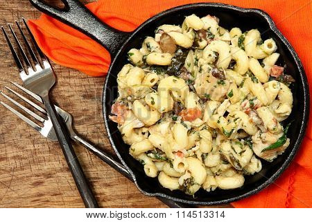 Skillet Baked Tuscan Chicken Pasta on table.