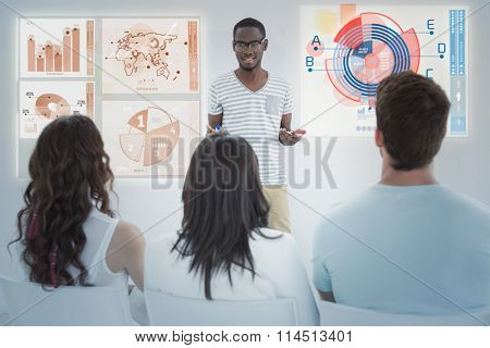 Global business interface against smiling businessman presenting at his colleagues