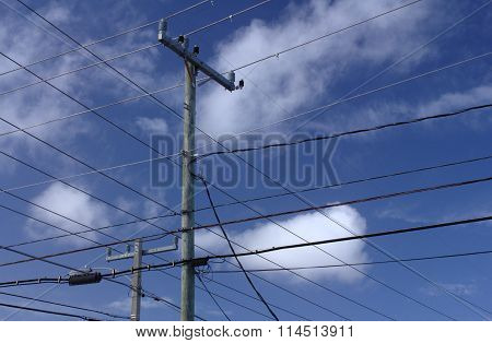Wires, sky and clouds