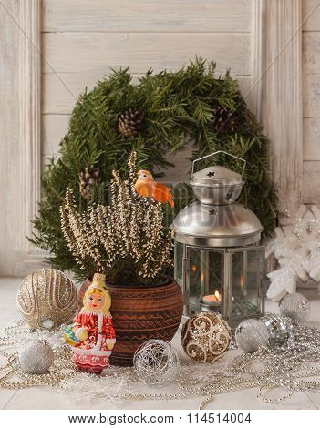 Heather On The Window With Christmas Toys On The Background Of The Christmas Tree Wreath (products O