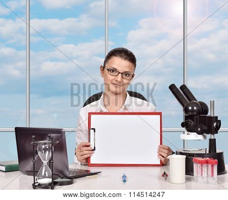 Female Medical Researcher With Clipboard
