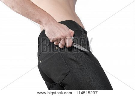 The woman in jeans with a knife in his hand on a white background.