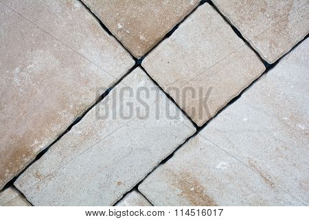 Background of granite paving stones stacked, paver and cube.