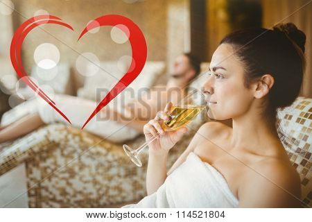 Woman enjoying her champagne against heart