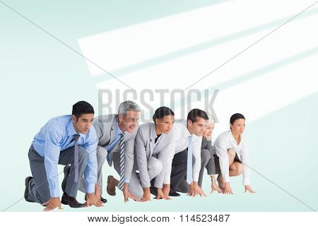 Business people preparing to run against blue vignette background
