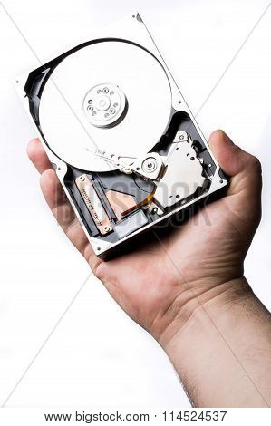 Male Technician Hand Holding Computer Hard Drive Over White Background