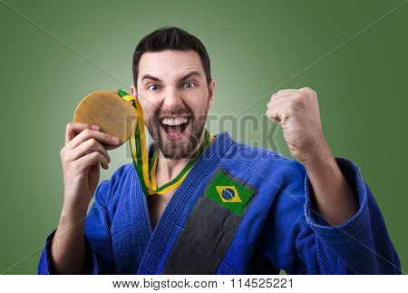 Brazilian judoka fighter on green background