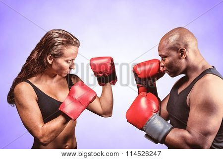 Athletes with fighting stance against purple background
