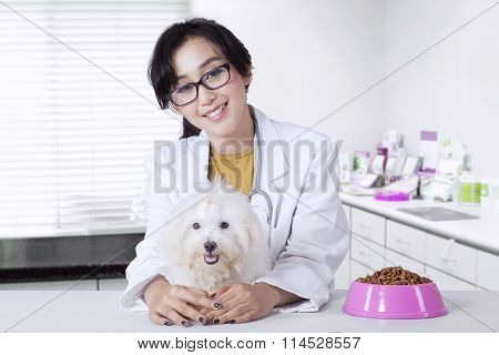 Veterinarian With Dog And Food Of Dog