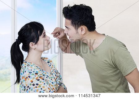 Young Husband Quarreling With His Wife