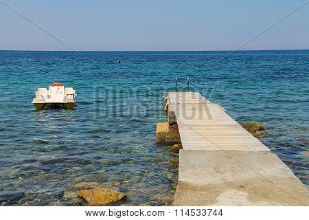 Catamaran Near The Pier On The Coast Of The Tyrrhenian Sea, Elba Island, Italy