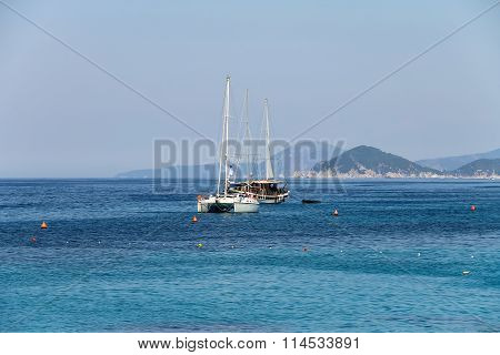 Anchored Sailboats In Waters Of Tyrrhenian Sea, Sant Andreas On Elba Island, Italy