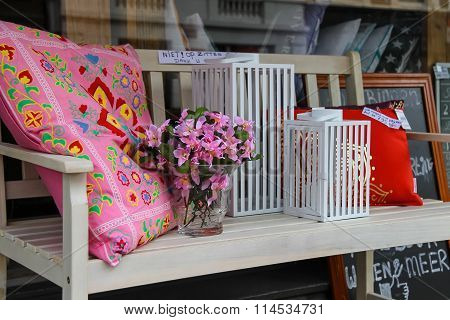 Decorative Wooden Bench With Cushions And Souvenirs Next To The Entrance To The Store In Haarlem, Th