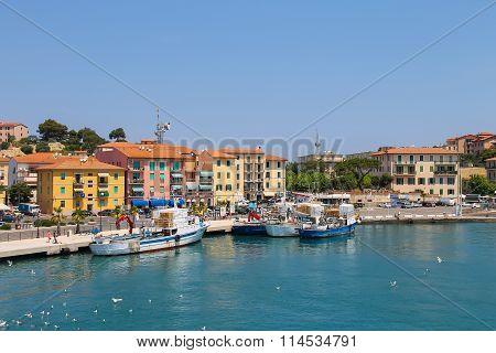 Cargo Boats In Portoferraio Harbour, View From The Sea. Elba Island, Tuscany, Italy
