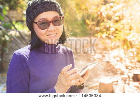 Asian Woman With Smiling Face Happiness Emotion And Smart Phone In Hand Use For People And Digital T
