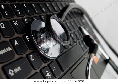 black stethoscope and keyboard