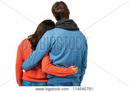 Rear view of couple holding each other against white background