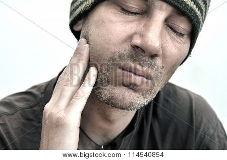 Man With Swollen Face Suffering From Toothache