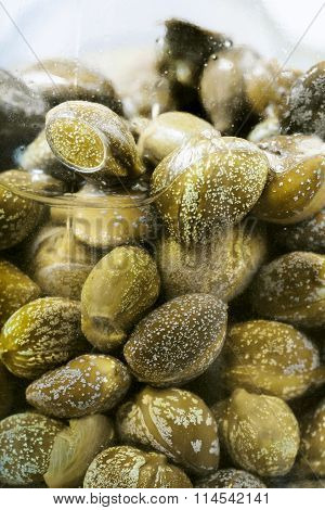Green Pickled Capers In Brine In Glass Jar