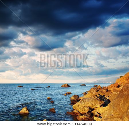 Summer Landscape With The Sea, Stones And The Cloudy Sky.