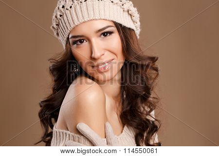 Happy woman in knitted sweater and hat. Fashion photo