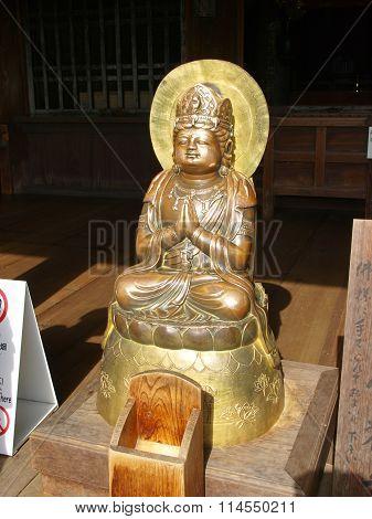 Ancient golden Buddha statue