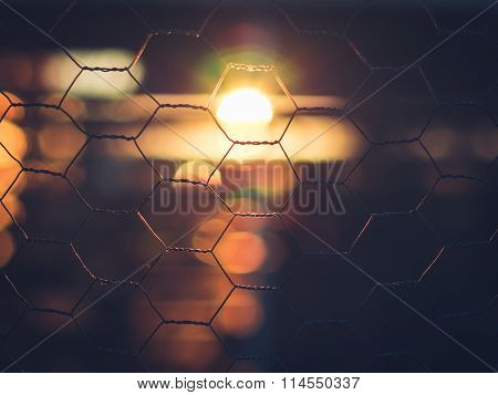 Beautiful Sunrise Through Fence with Backlight