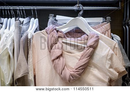 dresses on hangers in wardrobe